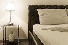 Table lamp and bed Stock Photography