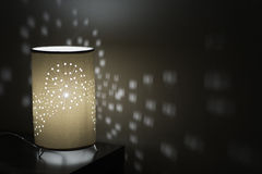 Table lamp on bedside cabinet Stock Image