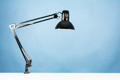 A table lamp. On blue background Stock Photography