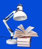 Table lamp with books Royalty Free Stock Photos