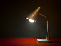 Table lamp. Is on on a dark backround Stock Photo