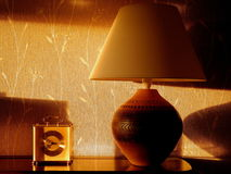 Table lamp, with evening sunlight. Stock Photos