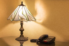 Table lamp and phone on desk Royalty Free Stock Photography