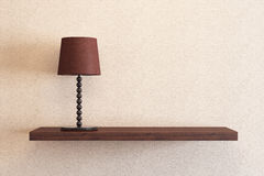 Table lamp on the shelf. Brown table lamp on the shelf Stock Photos
