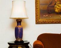 Table lamp and sofa Stock Photos