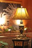 Table lamp stands on a pedestal yellow light shines Royalty Free Stock Photo