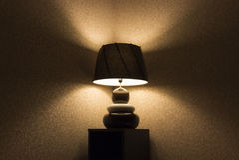 Table lamp. Stylish brown table lamp at night Stock Photo
