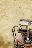 Table lamp typewriter desk chair on the old vintage textured paper background Royalty Free Stock Photography