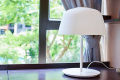 Table lamp on windowsill Royalty Free Stock Photography