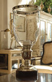 Table lamps. Lamp with glass shade in a candlestick stands on a table Stock Images
