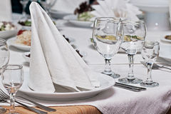 Table layout. On a table in a plate there is a snack from seafood Royalty Free Stock Image