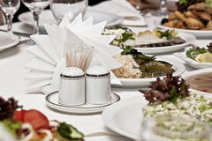 Table layout. On a table in a plate there is a snack from seafood Stock Image