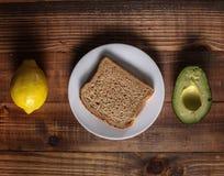 Table with lemon, avocado and bread Royalty Free Stock Photo