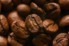 On the table lie roasted coffee beans stock photos