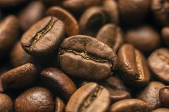Roasted coffee beans. On the table lie roasted coffee beans, close-up stock image