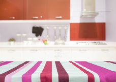 Table with linen tablecloth for present product on kitchen blur. Background Stock Images