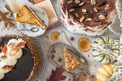 Table with loads of coffee, cakes, cupcakes, desserts, fruits, flowers and croissants. stock photos