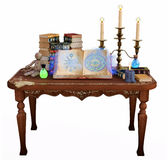 Table with magic potions and books Stock Images