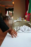 Table manner. Waiter arange the table at restaurant stock photography