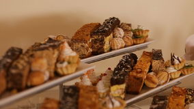 A table with many sweets, biscuits and cakes. Wedding dessert. stock video