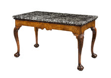 Table with marble top. Antique wooden table with marble top Stock Photo