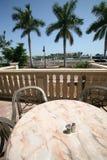 Table at the marina. A table overlooking a marina/boat dock Stock Photos
