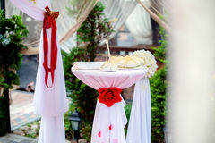 Table for marriage registration. With red ribbons Stock Photo