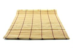 Table mat made out of bamboo pieces. On isolated background royalty free stock photo