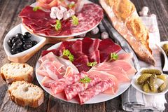 Table with meat, bread, olive Stock Images