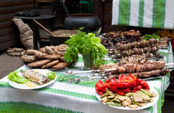 Table with meat dishes Royalty Free Stock Images