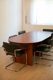 Table for meetings. Wooden table for meetings at modern office Stock Image