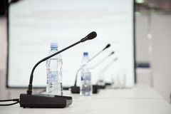 Table microphone. At conference hall Royalty Free Stock Photography