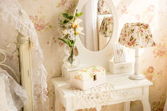 Table with mirror and flowers in provence style Stock Images