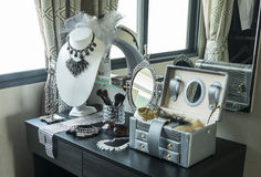 Table mirror,sunglasses,jewelry and makeup brushes on a table Royalty Free Stock Images