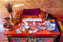 Table with money for making merit Inside Guru Rinpoche Temple at Namchi. Sikkim, India Stock Images