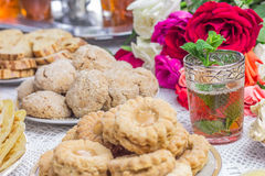 Table with Moroccan cookies and tea Stock Images