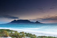Table Mountain. From Milnerton beach with grass in the foreground Stock Photo