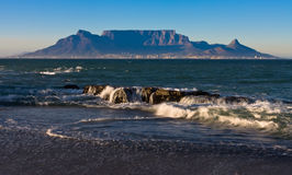 Table Mountain. Early morning waves overlooking table mountain from blouberg starnd Royalty Free Stock Photos