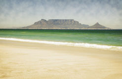 Table Mountain from Bloubergstrand. Table Mountain, viewed from Bloubergstrand over Table Bay, showing beach in the foreground Royalty Free Stock Photo