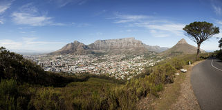Table Mountain and Cape Town. Table Mountain, Lion's Head and Devil's Peak with 12 Apostles in back, Cape Town, South AFrica, from Signal Hill Drive Royalty Free Stock Image