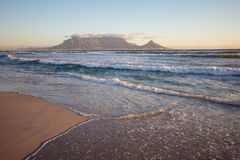 Table mountain and Cape Town. VIew of Cape Town and Table Mountain from Dolphin Beach at Sunset, South Africa Stock Photo