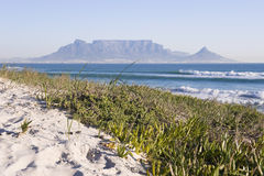 Table mountain Cape Town. Table Mountain - the world famous landmark in Cape Town, South Africa. Picture taken on a clear Winters day from the Blouberg Strand Stock Photos