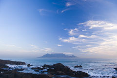 Table mountain Cape Town. Table Mountain - the world famous landmark in Cape Town, South Africa. Picture taken on a clear Winters day from the Blouberg Strand Stock Images