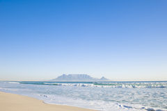 Table mountain Cape Town. Table Mountain - the world famous landmark in Cape Town, South Africa. Picture taken on a clear Winters day from the Blouberg Strand Stock Image