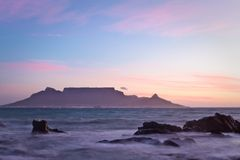 Table Mountain at dawn. Vista of Table Mountain at dawn as seen from Bloubergstrand Stock Photos