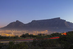 Table Mountain at dusk with passing cars Royalty Free Stock Photos