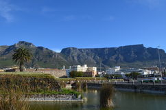 Table mountain from the harbor. A clear view of table mountain from a harbor in Cape Town South Africa Stock Photography