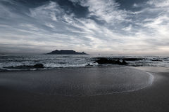 Table Mountain from Melkbosstrand. On the beach Royalty Free Stock Images