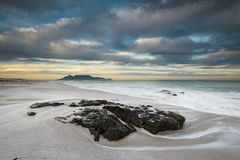 Table Mountain and Robben Island. At Dawn with cool light Stock Images