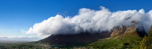 Table Mountain under huge white cloud on blue sky background beautiful landscape panorama, scenery panoramic view of capital city stock photography